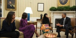 President Barack Obama, First Lady Michelle Obama, and their daughter Malia meet with Malala Yousafzai, the young Pakistani schoolgirl who was shot in the head by the Taliban a year ago, in the Oval Office, Oct. 11, 2013. (Official White House Photo by Pete Souza)